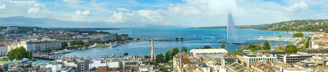Panoramic view of Geneva and the jet d'eau on a sunny day